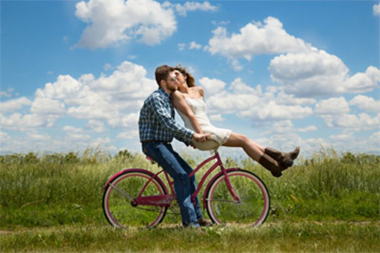 Boy & Girl on a bicycle
